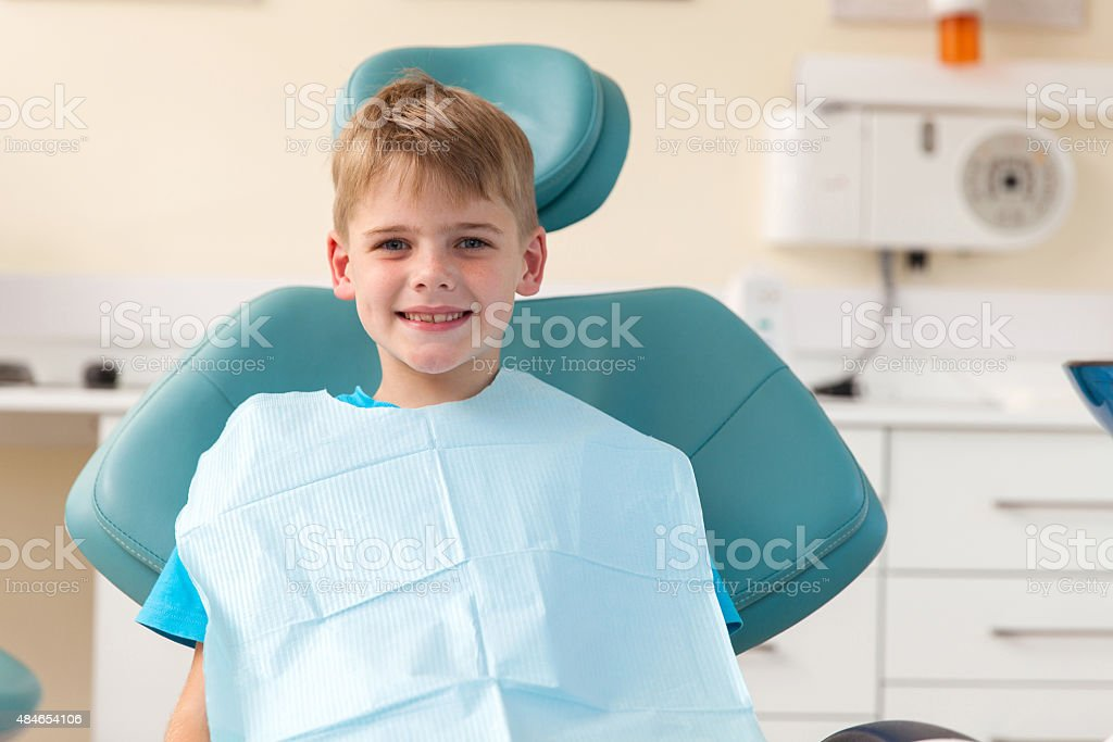 little boy in dentist's office stock photo
