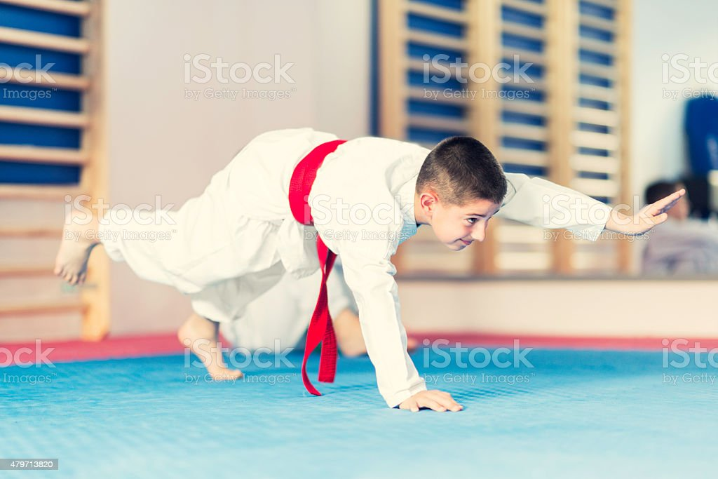 Little Boy In Martial Arts Training Class stock photo