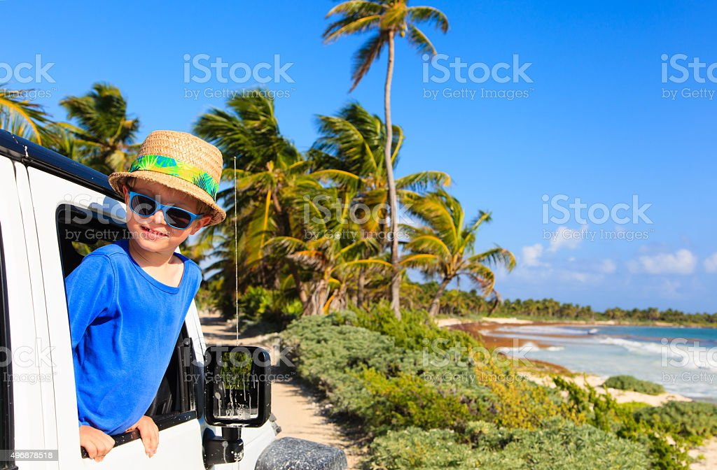 little boy in off road car, family vacation stock photo