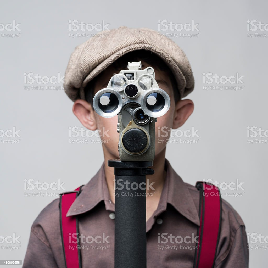 Little Boy In Old Fashioned Style Filming Via Antique Camera stock photo