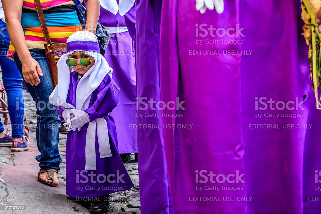 Little boy in Palm Sunday procession, Antigua, Guatemala stock photo