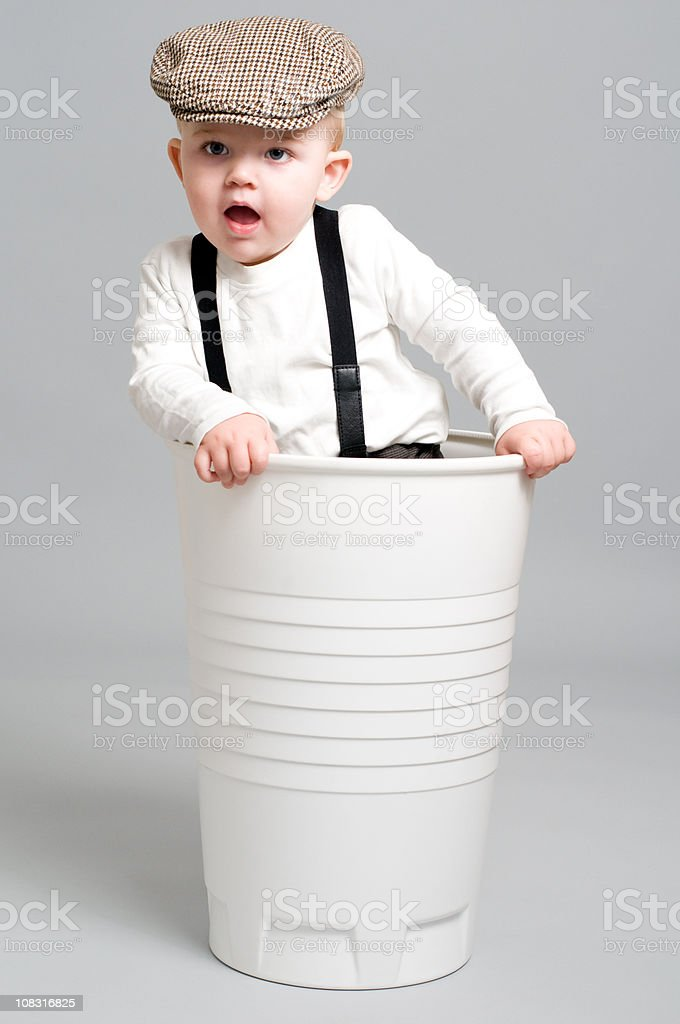 Little Boy in Paper Cup is having fun stock photo