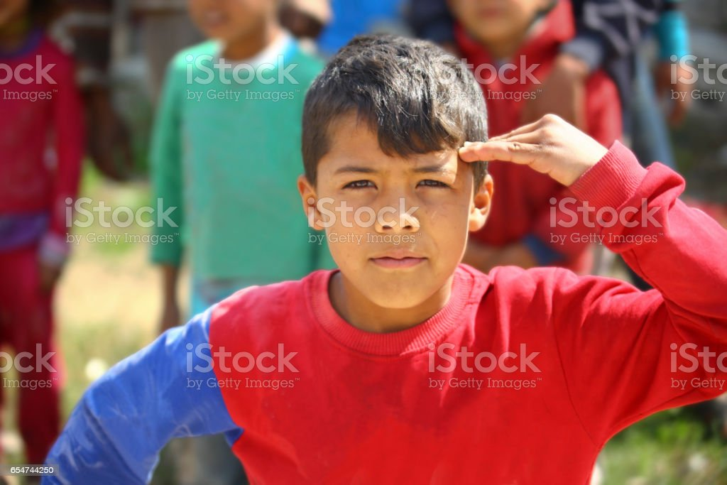 little boy in refugee camp stock photo