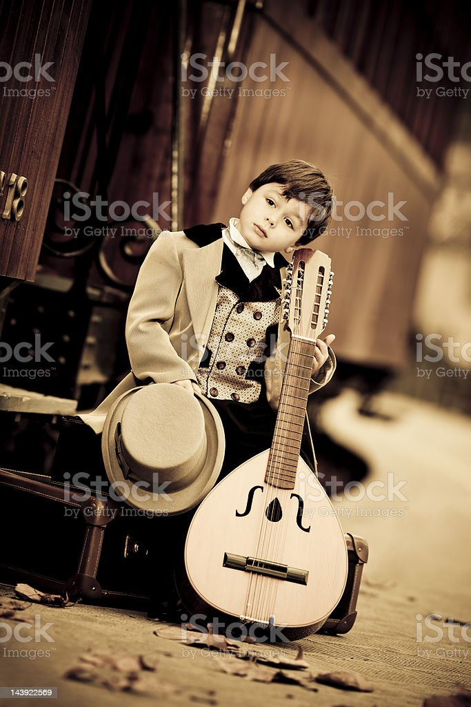 little boy in retro style as musician royalty-free stock photo