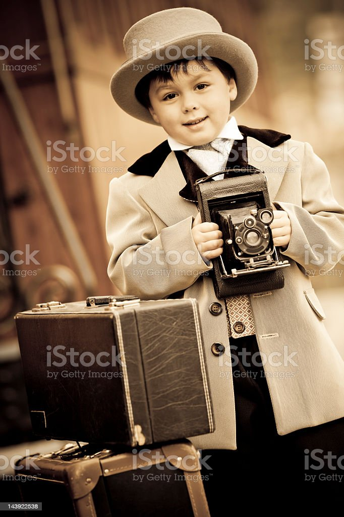 little boy in retro style with an old camera stock photo