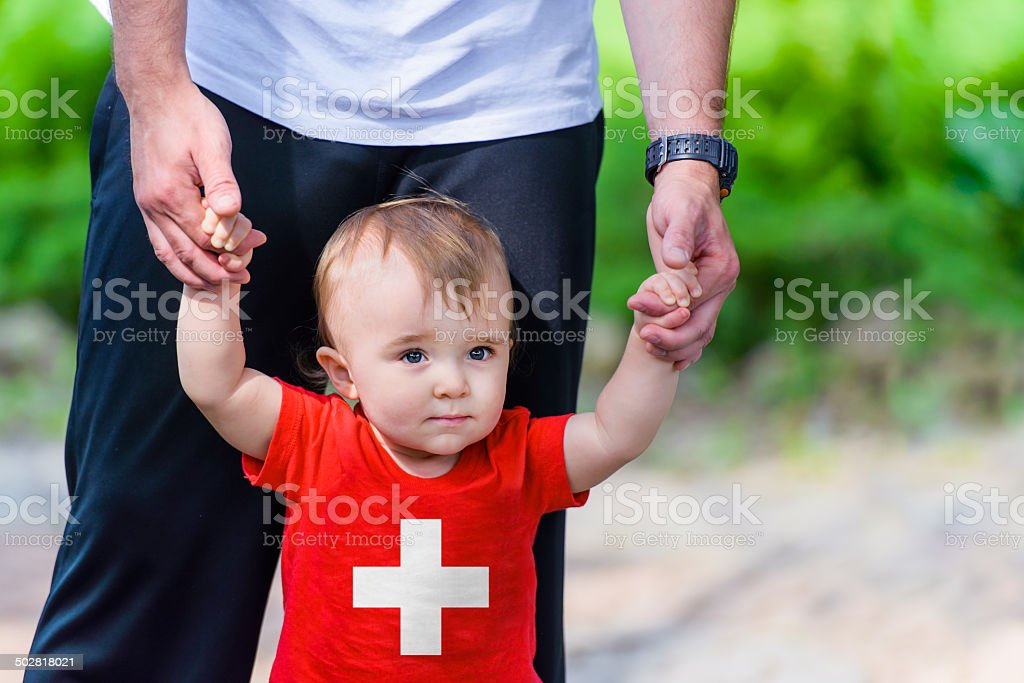 Little Boy in Switzerland Flag shirt stock photo