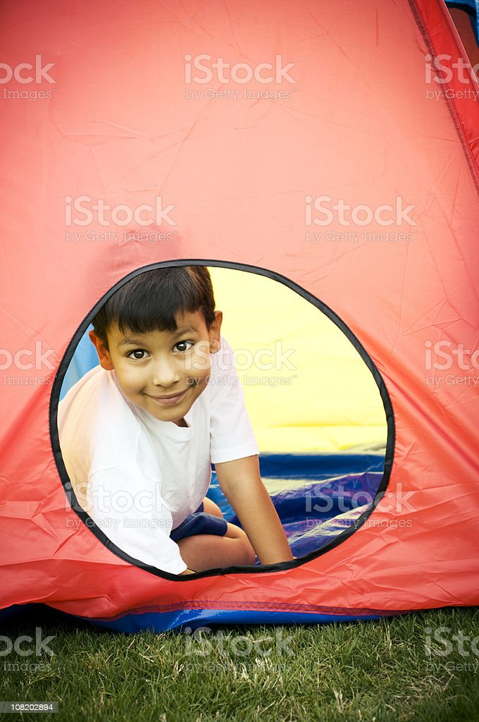 Little Boy in Tent Outdoors royalty-free stock photo