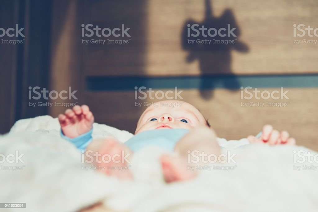 Little boy in the bed stock photo