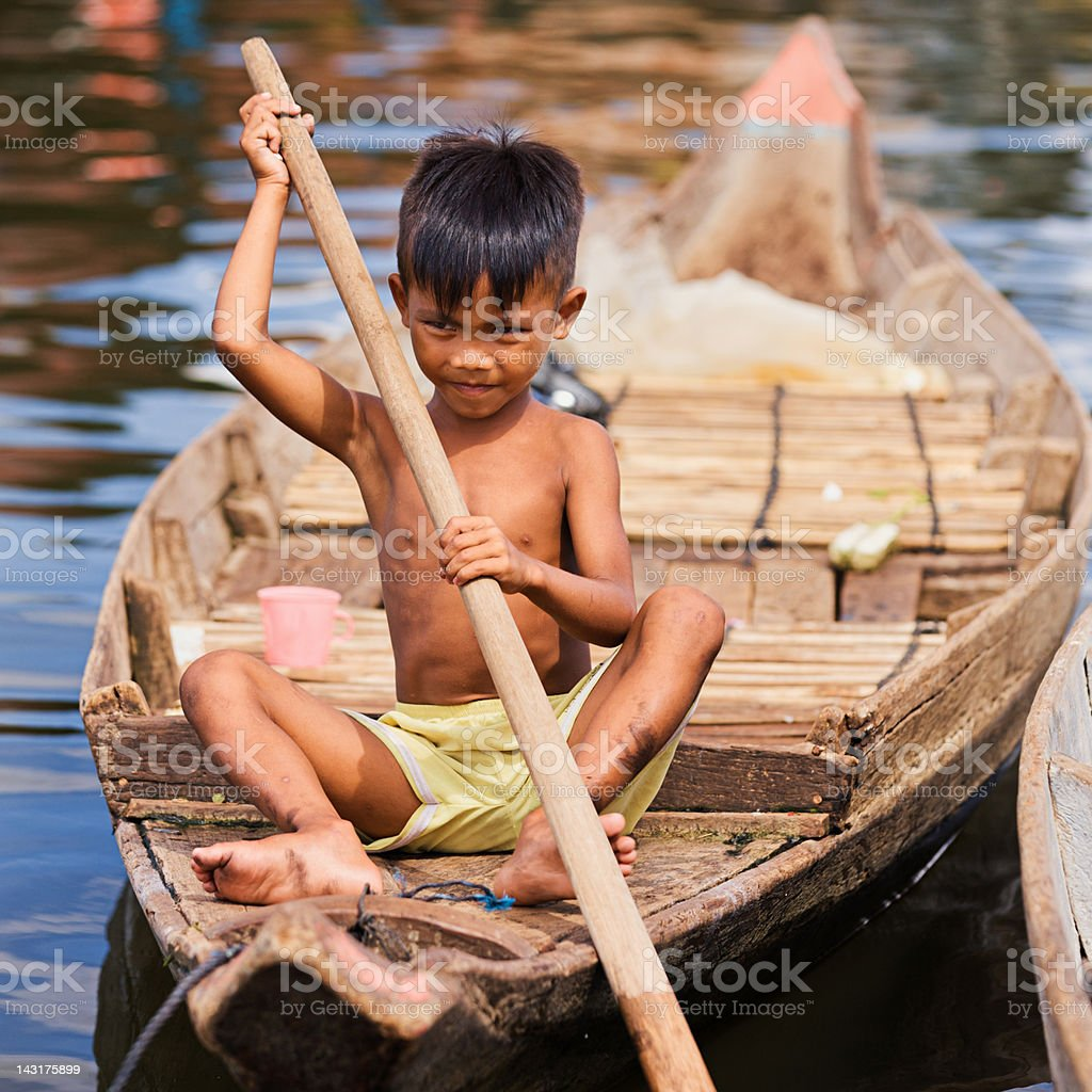 Little boy in the boat, Cambodia royalty-free stock photo
