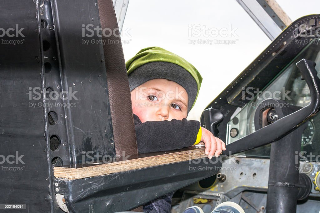 Little boy in the cockpit stock photo