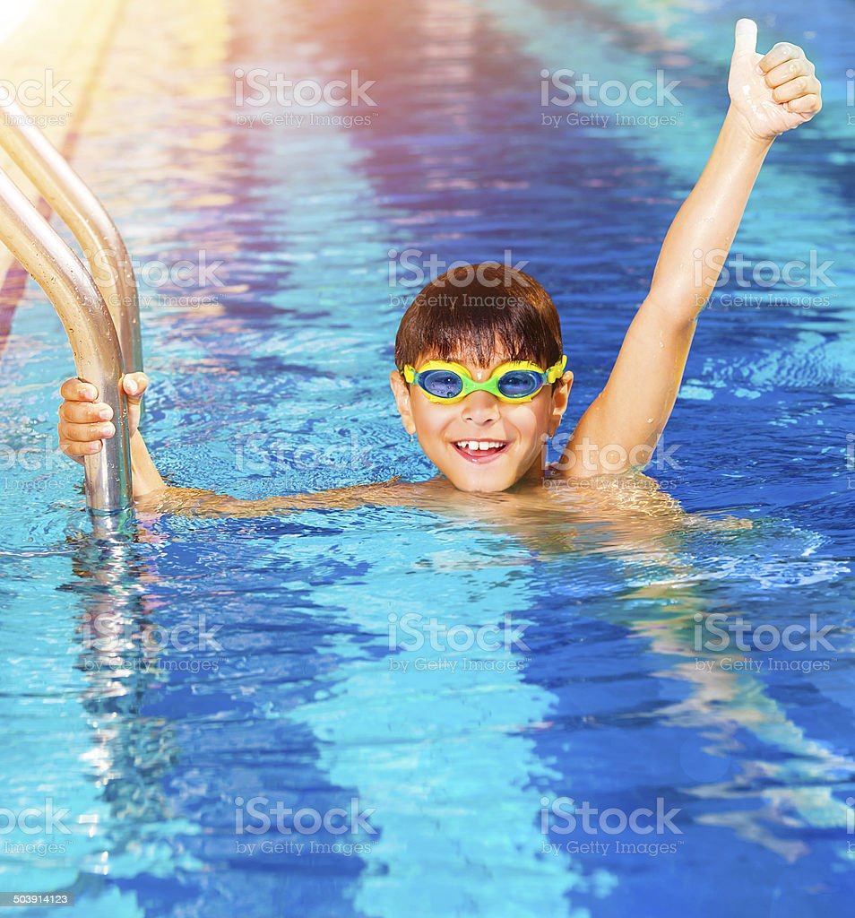 Little boy in the pool stock photo