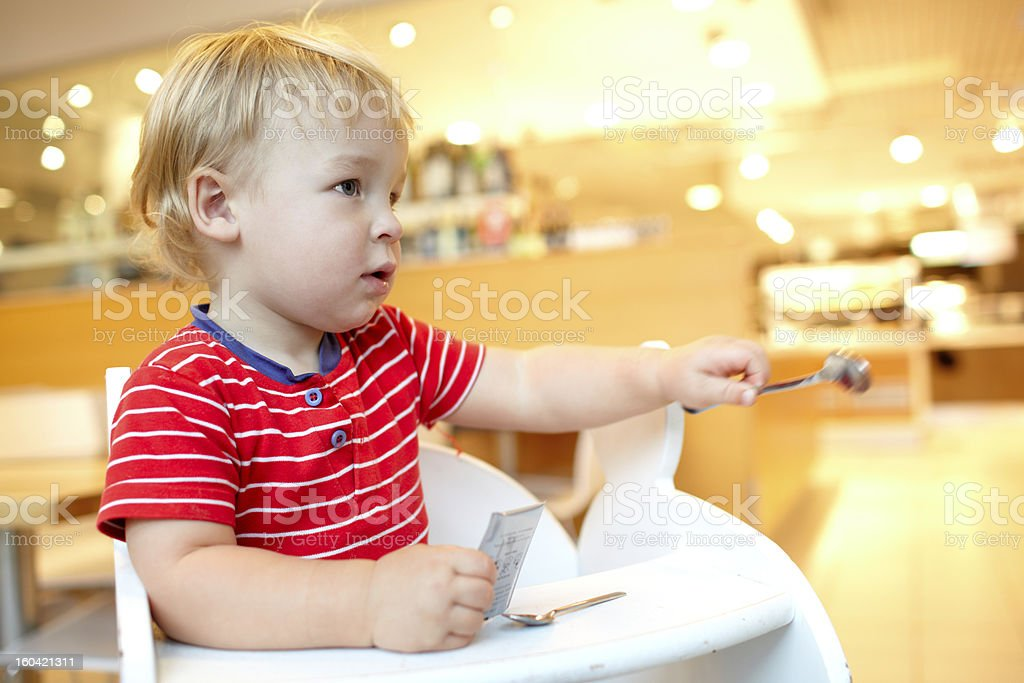 Little boy in the restaurant. royalty-free stock photo