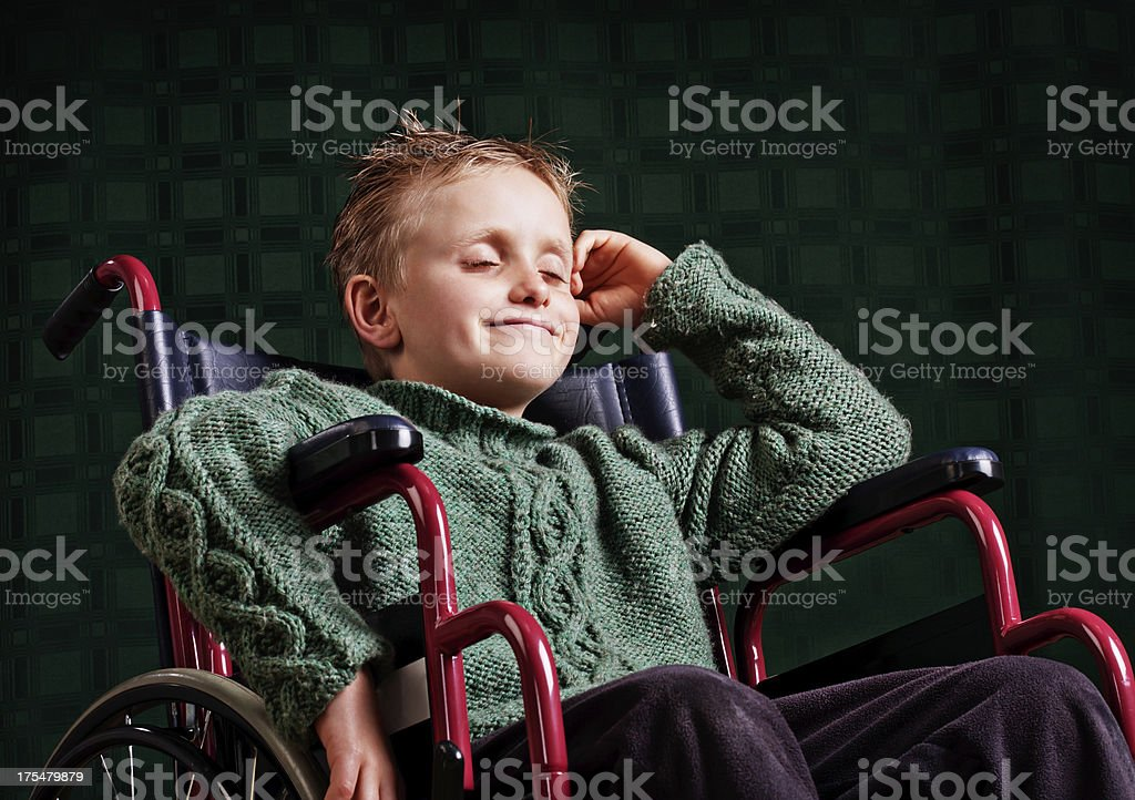 Little boy in wheelchair dreams of a better future stock photo