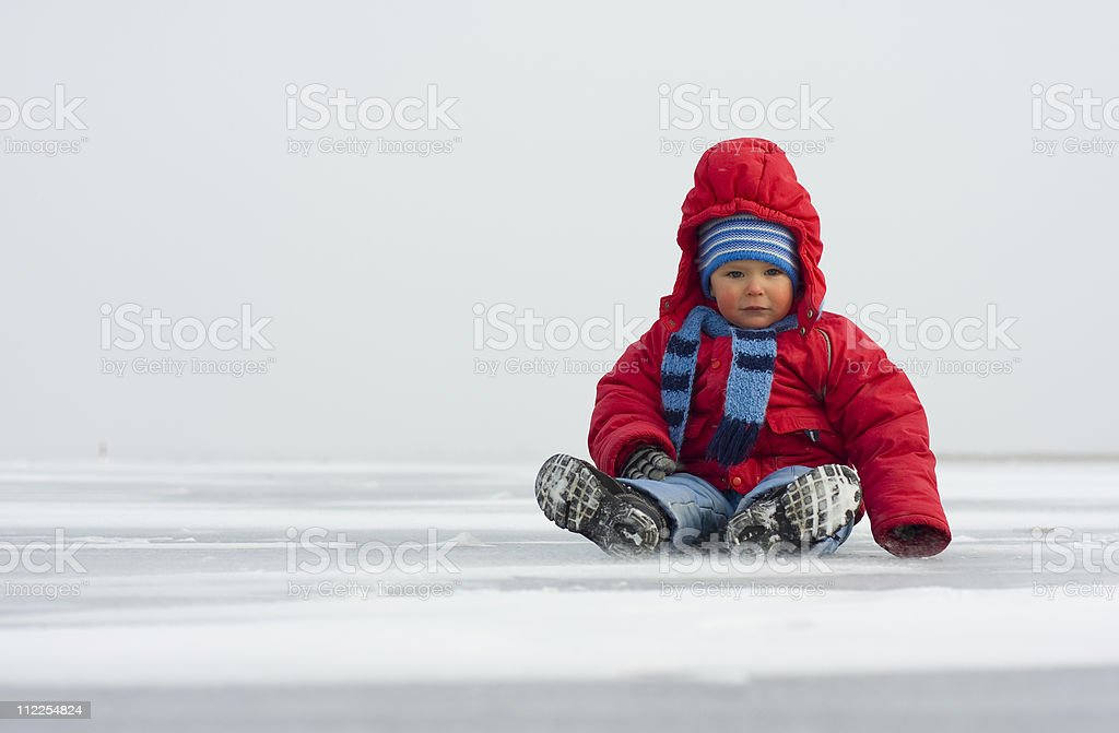 Little boy in winter on ice stock photo