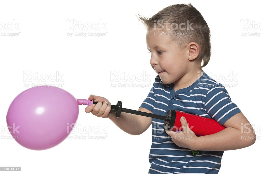 Little boy inflates a balloon stock photo
