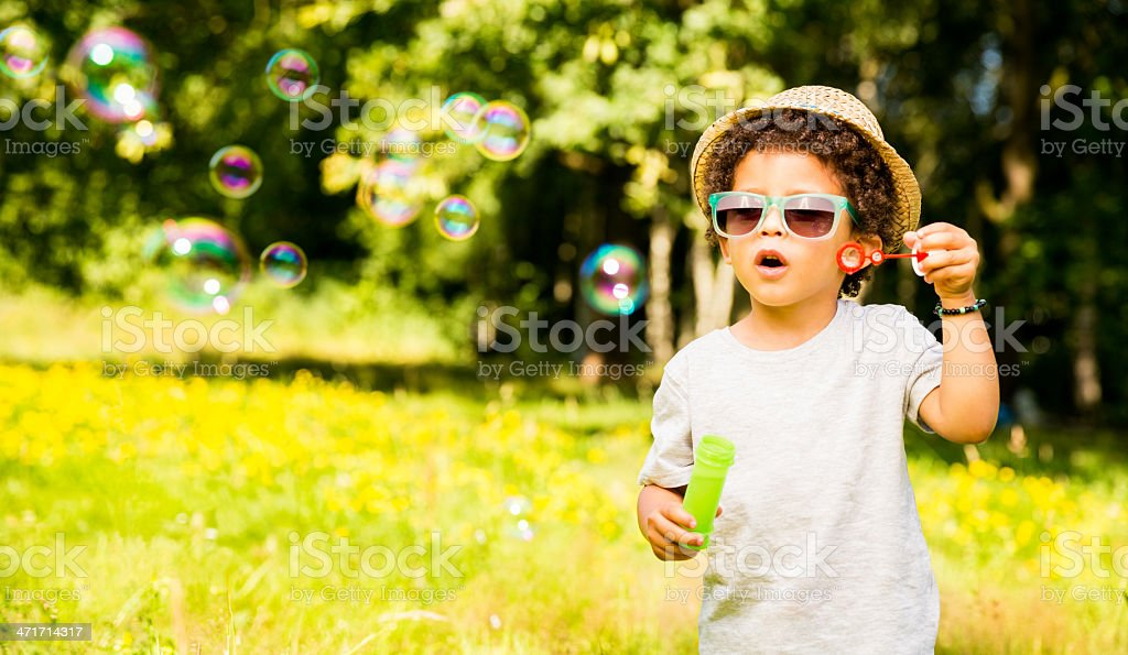 Little Boy is amazed by bubbles royalty-free stock photo
