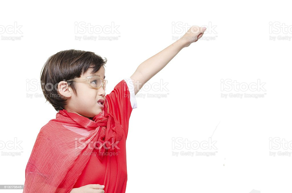 Little boy is dressed up as a superhero flying stock photo
