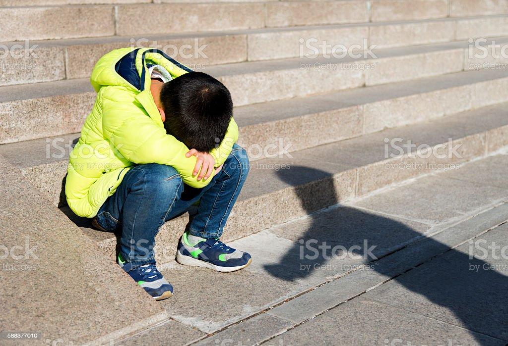 Little boy is in distress outdoors stock photo
