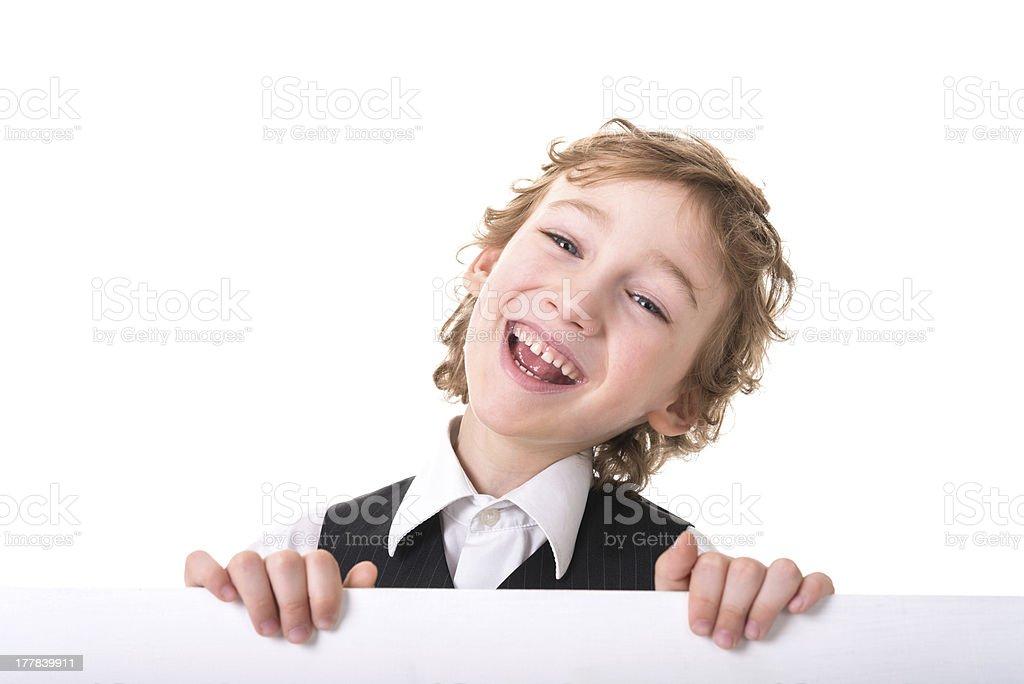Little boy is peeking from blank sign royalty-free stock photo