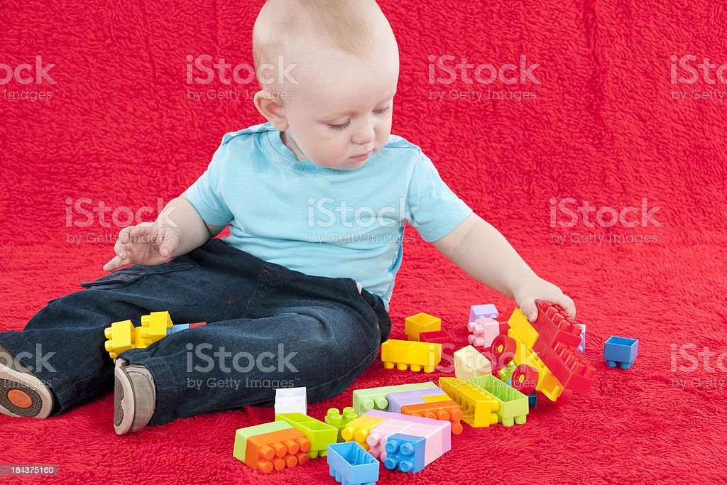little boy is playing with blocks royalty-free stock photo