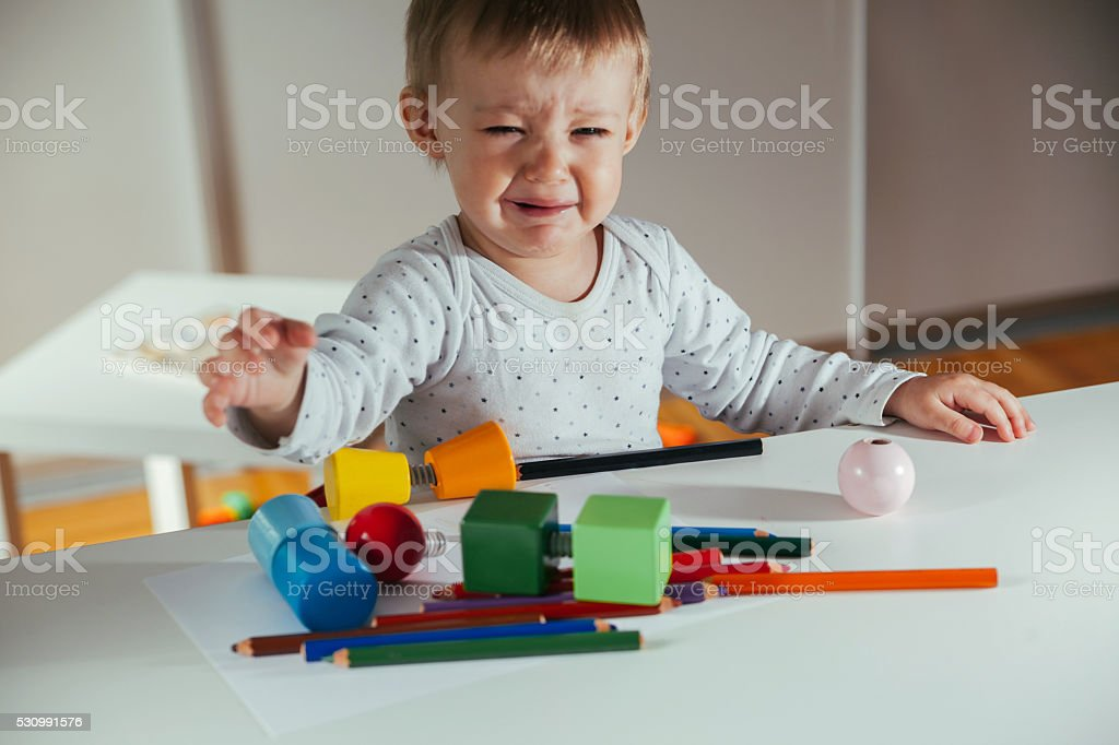 Little Boy Is Playing With Toys stock photo