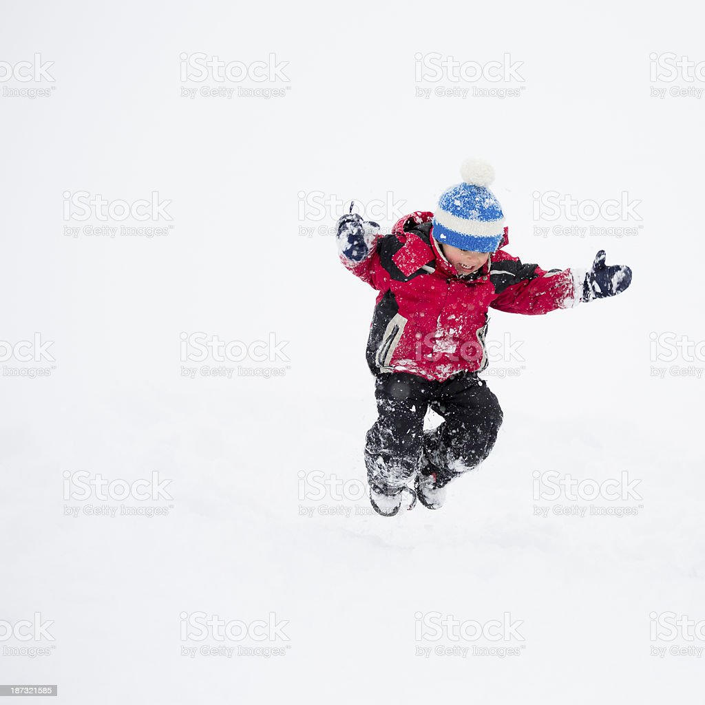 Little boy jumping in snow royalty-free stock photo