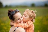 Little Boy Kisses Mom