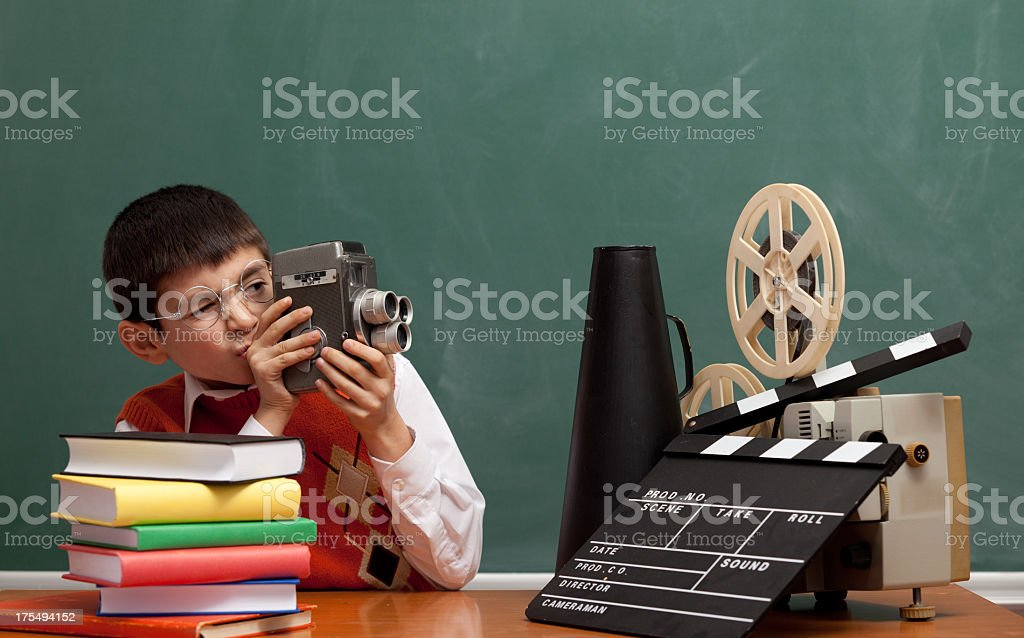 Little boy learning how to make film via video camera stock photo