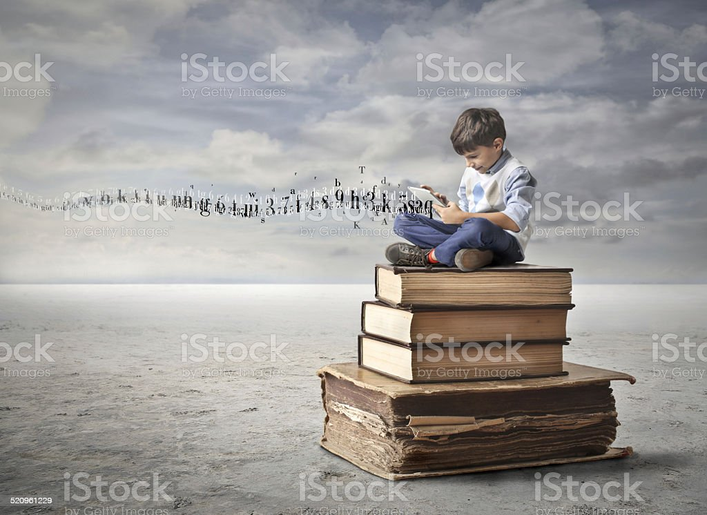 Little boy learning stock photo