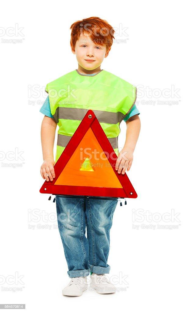Little boy learning road traffic regulations stock photo