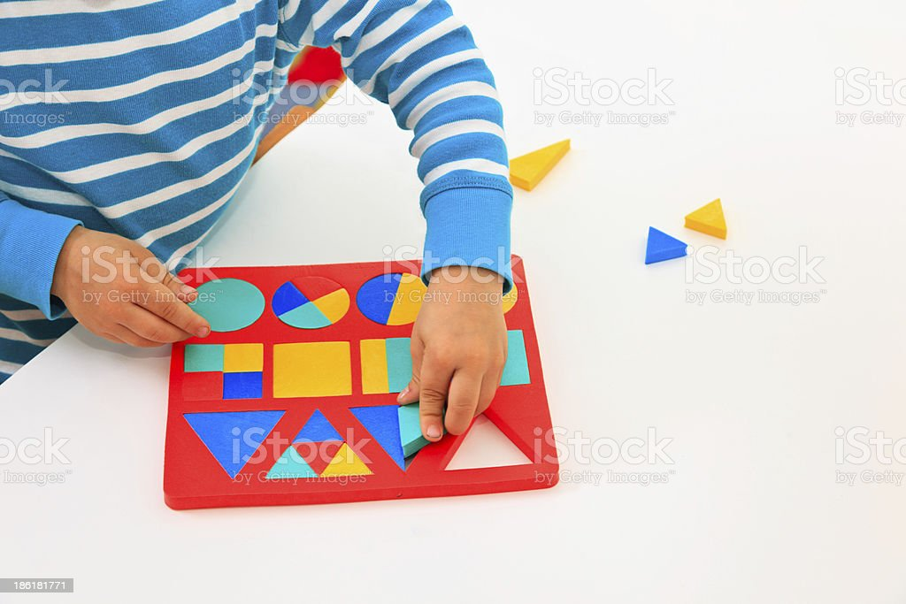little boy learning shapes royalty-free stock photo