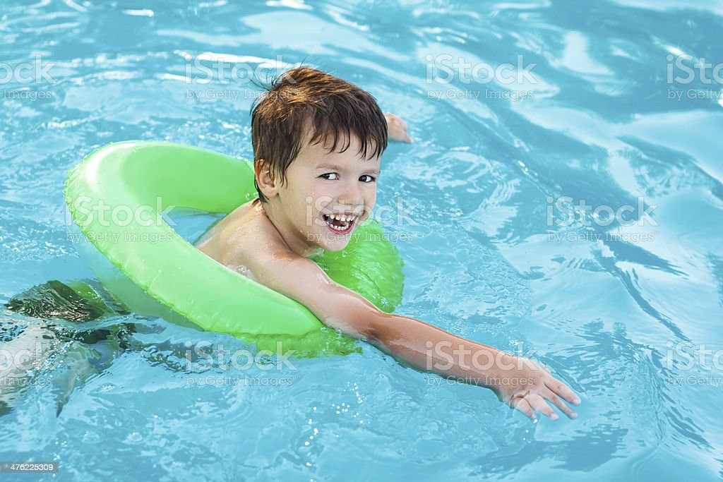 Little boy learning swim with saver royalty-free stock photo