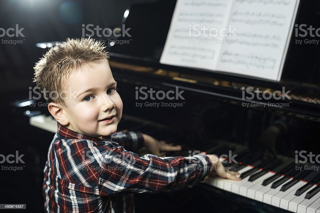 Little boy learning to play the piano. royalty-free stock photo