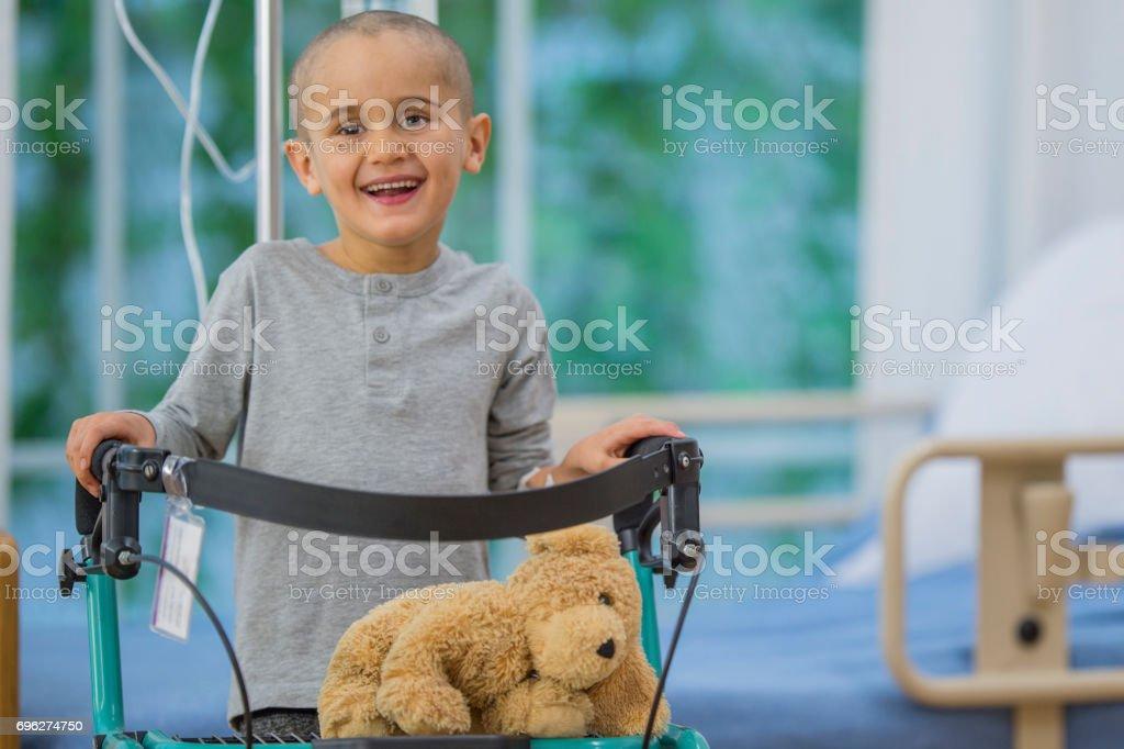 Little Boy Learns to Walk Again stock photo