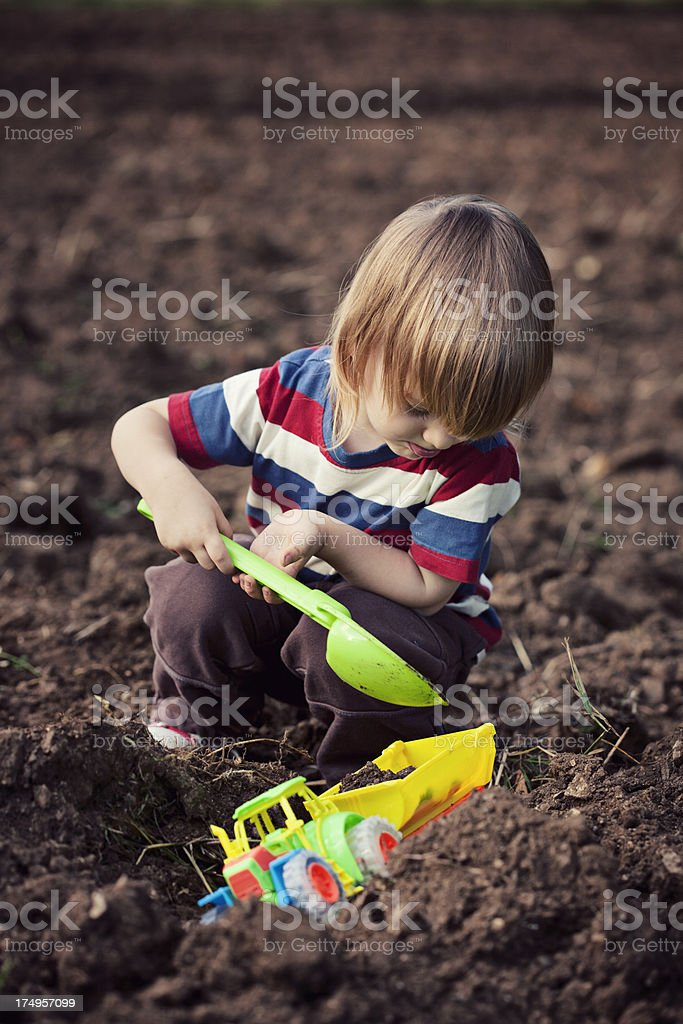 Little boy loading tractor trailer royalty-free stock photo