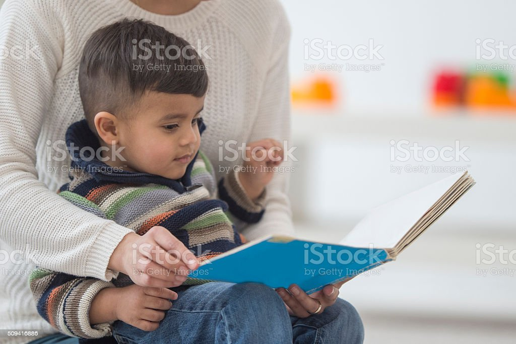 Little Boy Looking at a Book stock photo