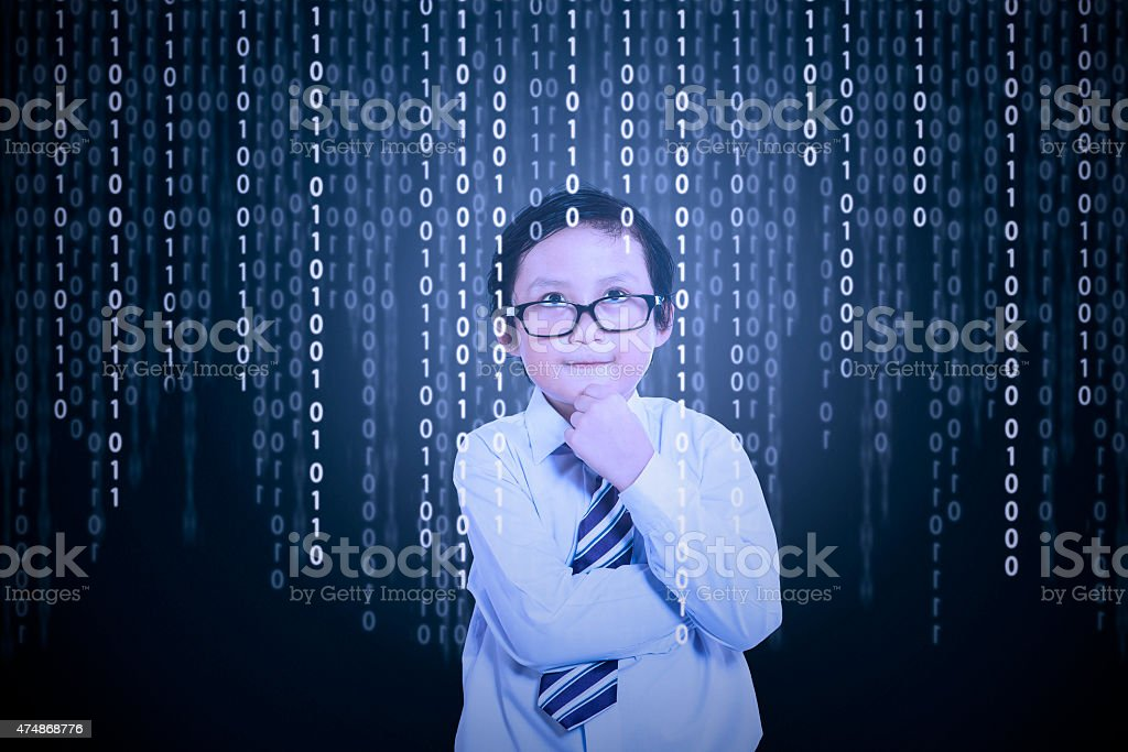 Little boy looking at binary code stock photo