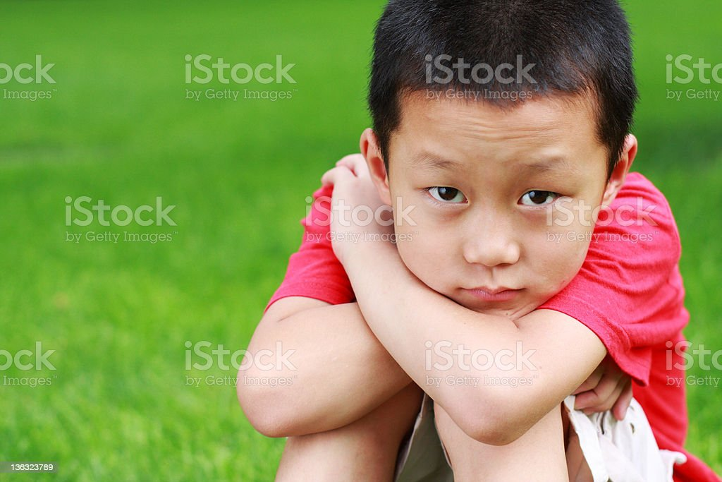 little boy looking at camera stock photo
