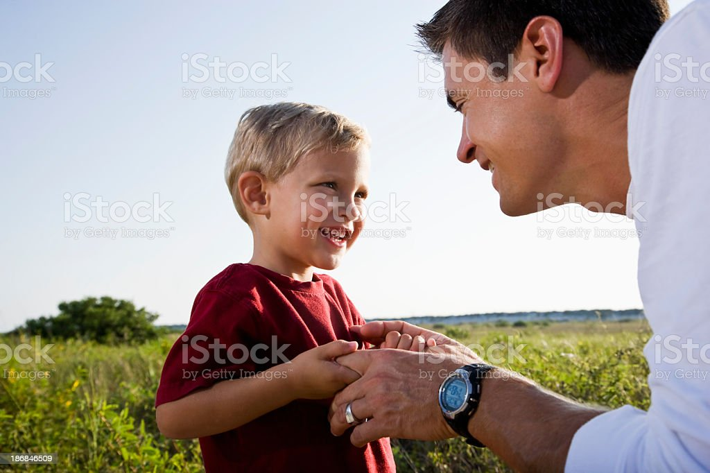 Little boy looking at dad with big grin royalty-free stock photo