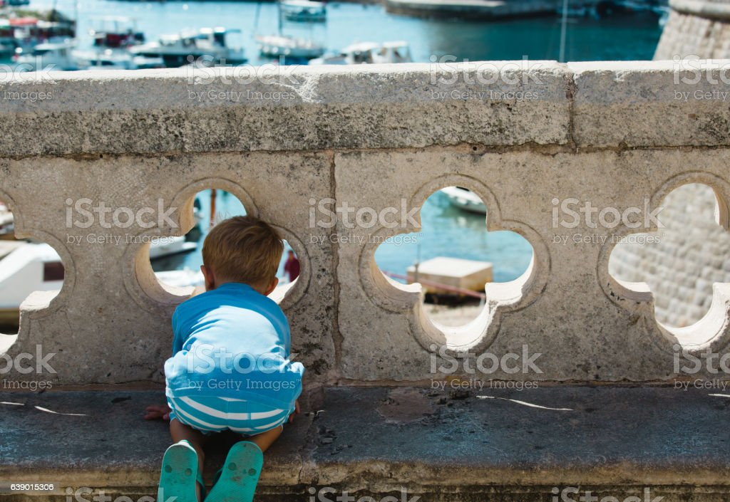 little boy looking at Dubrovnik from old city walls stock photo
