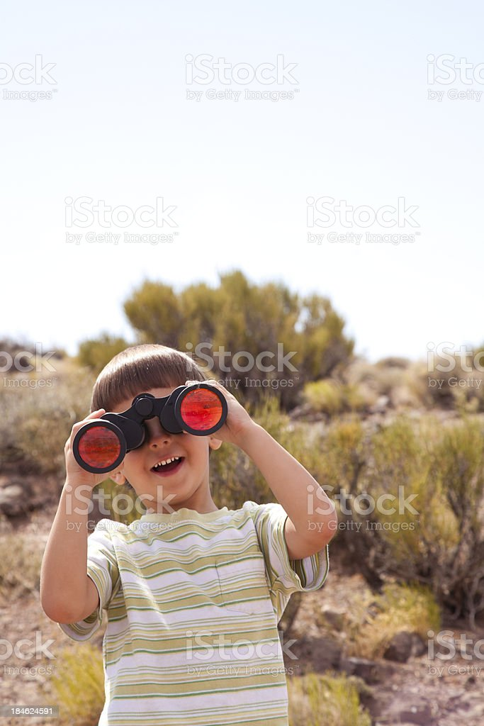 Little boy looking forward with binoculars royalty-free stock photo