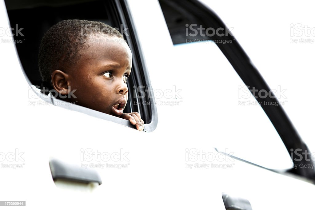 Little boy looking out of window stock photo