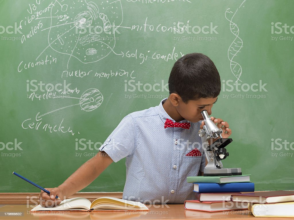 Little boy looking through microscope royalty-free stock photo