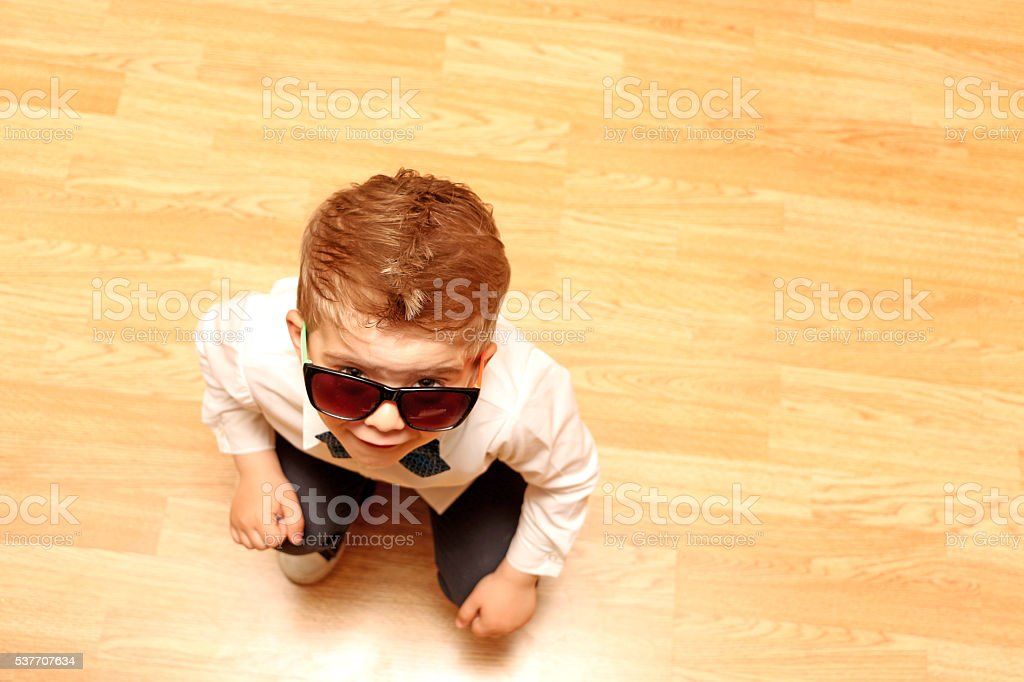 little boy looking  upwards stock photo