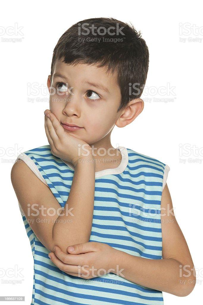 Little boy looks aside stock photo