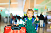 little boy loves travel in the airport