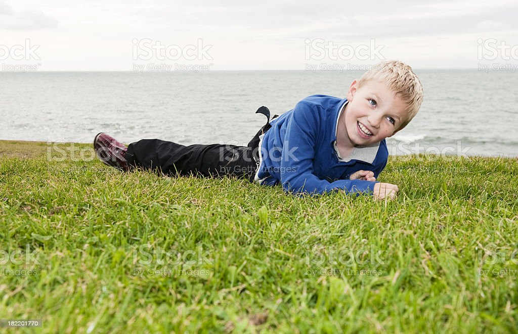 little boy lying on grass royalty-free stock photo