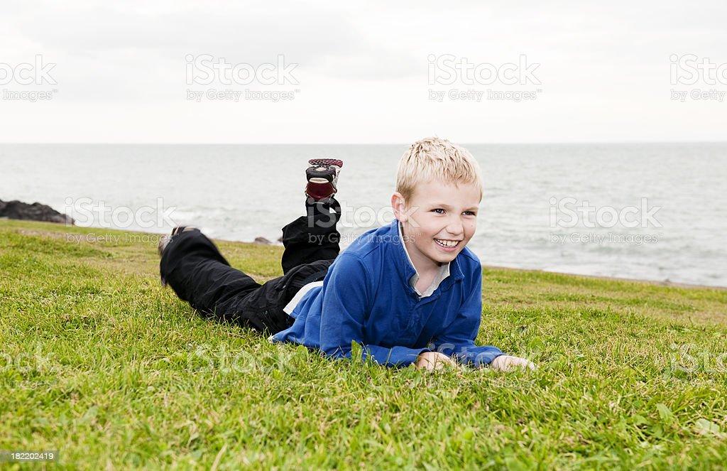 little boy lying on grass royalty-free stock photo