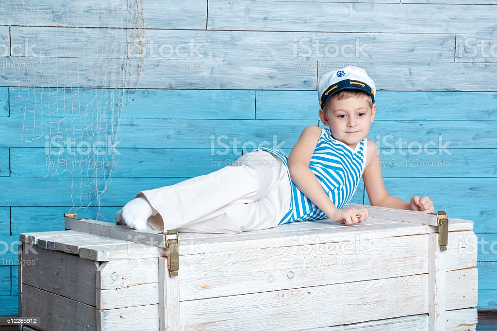 little boy lying on the chest stock photo