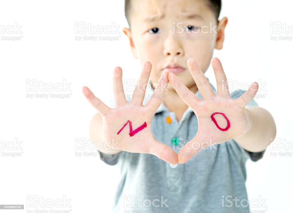 Little boy makes a stop gesture stock photo